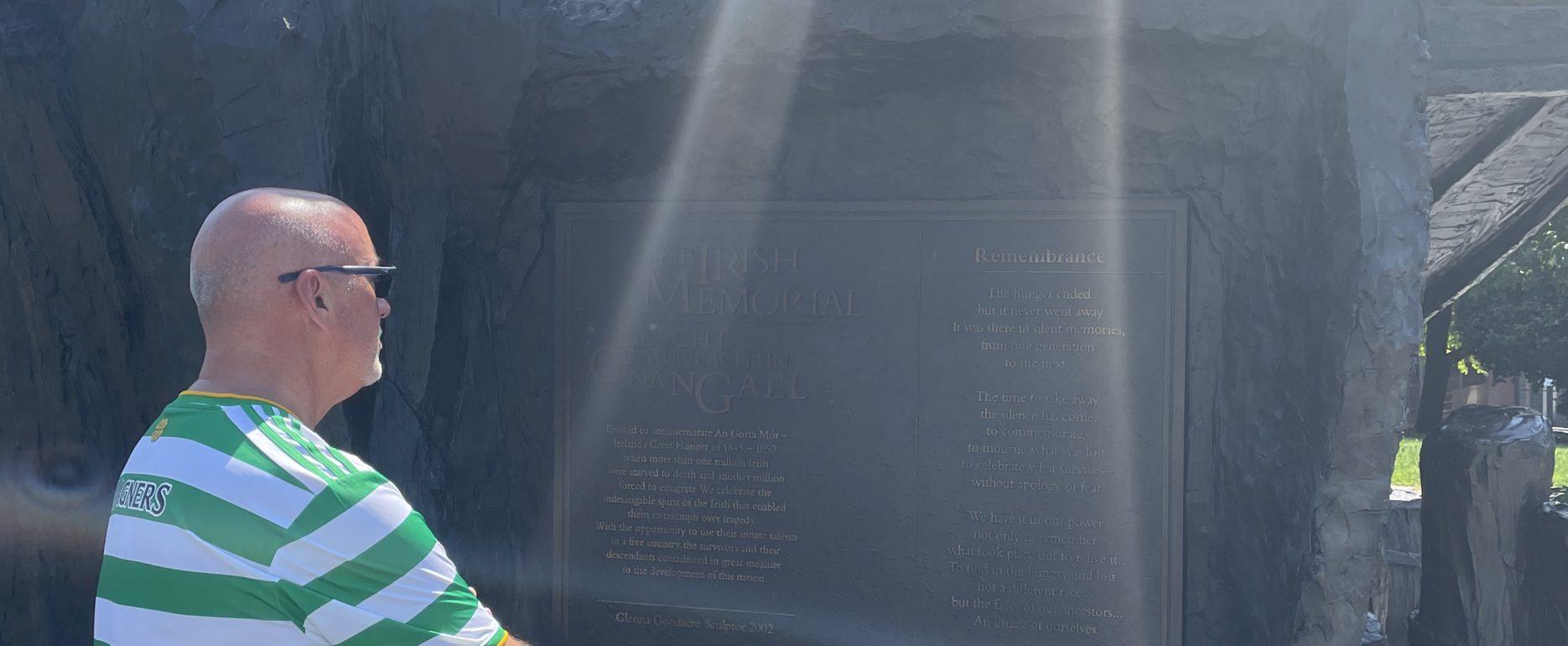 Joe Brooks reflecting at the Philadelphia Irish Memorial